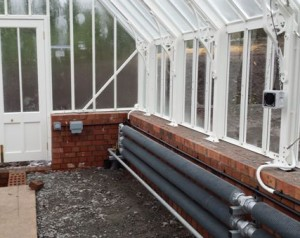 Heating Pipes installed on the greenhouse perimeter wall.